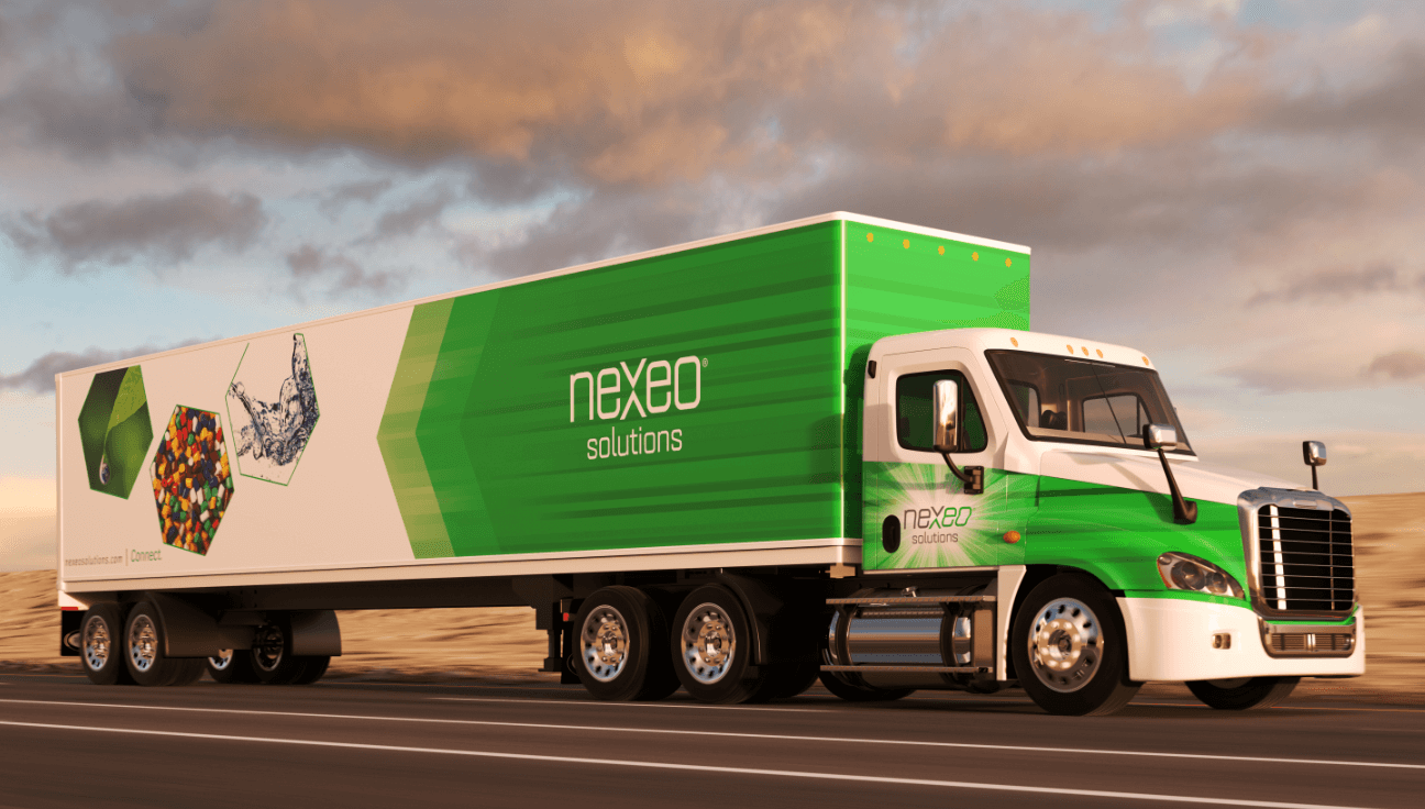 Two workers speaking in front of a nexeo truck